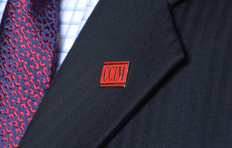 CCIM pin on a jacket lapel
